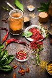 Herbs and spices selection with colorful peppercorns and dry chili on rustic wooden background Stock Photos