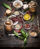 Herbs and spices selection on dark rustic  grunge background Stock Photography