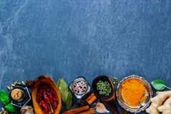 Herbs and spices selection. Top view of vatious dry herbs and spices selection for cooking on grey stone background, top view, copy space. Clean eating, vegan Stock Photo