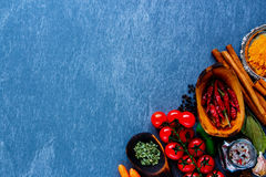 Herbs and spices selection. Vegetables with herbs and spices selection for healthy cooking on grey stone background, top view, copy space. Clean eating, vegan Stock Image