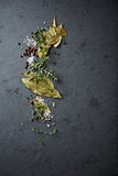Herbs and spices on a stone background Royalty Free Stock Photography
