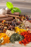 Herbs spices and teas. Herbs, spices and teas as a colorful background on a wooden table Stock Photography