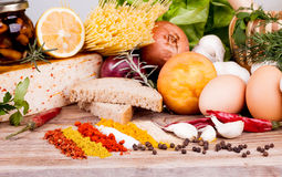 Herbs, Spices and vegetables on wooden table Royalty Free Stock Photos