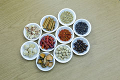 Herbs and spices in white bowls on wooden table Royalty Free Stock Photography