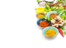 Herbs spices white background Healthy organic food. Herbs and spices on white table background. Curry, turmeric, ginger, rosemary, basil. Healthy organic food royalty free stock images