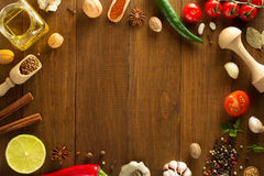 Herbs and spices on wood background Royalty Free Stock Images