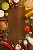Herbs and spices on wood background Royalty Free Stock Photos