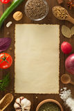Herbs and spices on wood background Stock Photos
