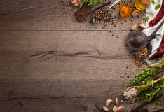 Herbs and spices on wood table Stock Photos