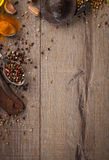 Herbs and spices on wood table. Frame of herb, healthy or vegetarian concept, top view, copy space Royalty Free Stock Image