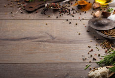 Herbs and spices on wood table. Frame of herb, healthy or vegetarian concept, top view, copy space Stock Photo