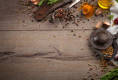 Herbs and spices on wood table Royalty Free Stock Image