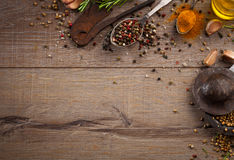 Herbs and spices on wood table Royalty Free Stock Photos