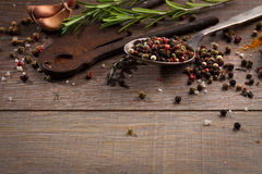 Herbs and spices on wood table Stock Images