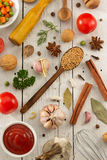 Herbs and spices on wood Royalty Free Stock Photo