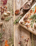Herbs and spices on  wooden background Royalty Free Stock Images