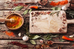 Herbs and spices on  wooden background Royalty Free Stock Photos