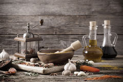 Herbs and spices on  wooden background Stock Photography