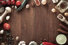 Herbs and spices on wood background. Herbs and spices on wooden background Royalty Free Stock Images
