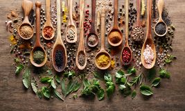 Herbs and spices on wooden board royalty free stock photos
