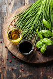 Herbs and spices on wooden board Stock Image
