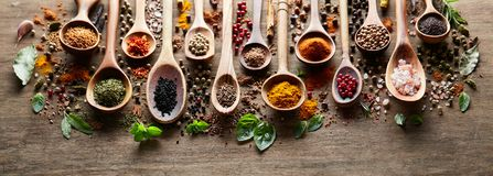 Herbs and spices on wooden board Royalty Free Stock Photo