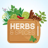 Herbs and spices with wooden chopping board Stock Photo