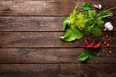Herbs and spices on wooden culinary background, ingredients for cooking, top view, space for text Stock Photo