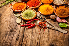 Herbs and spices on wooden table Royalty Free Stock Photo