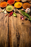 Herbs and spices on wooden table Stock Image