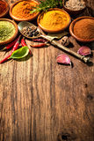 Herbs and spices on wooden table Stock Photos