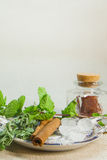 Herbs for tea and a lemon on a linen background. Herb and spice ingredients on a grey background royalty free stock photos