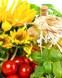Herbs with tomatoes, sunflowers and oil Royalty Free Stock Photos