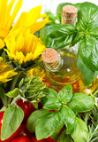 Herbs with tomatoes, sunflowers and oil Stock Image
