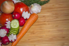 Herbs and vegetables with a blank chopping board. Space for copy. Royalty Free Stock Image