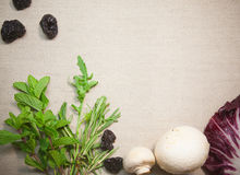 Herbs and vegetables on linen background Stock Photos