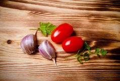 Herbs and vegetables on a new burned wooden background. Toned Stock Photo