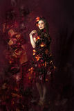 Herbstblumenphantasiefrau Stockfotografie
