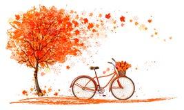 Herbsthintergrund mit einem Baum und einem Fahrrad Lizenzfreie Stockfotos