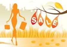 Herbsthintergrund mit Einkaufenfrau Stockfotografie