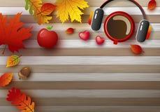 Herbsthintergrunddesign der Kaffeetasse und des Kopfhörers mit Blättern Stockfotos
