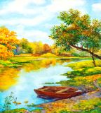 Herbstpark mit kleiner Brücke Boot nahe in Fluss
