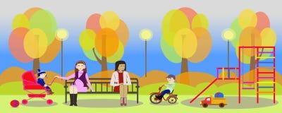 Herbstpark und -mütter mit Kindern auf Spielplatz Stockbild