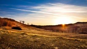 Herbstsonnenuntergang auf den Gebieten Lizenzfreie Stockbilder