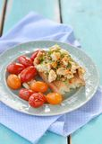Herby tofu scramble. Bruschetta with herby tofu scramble,and grilled  cherry tomatoes Stock Photos