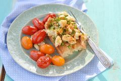 Herby tofu scramble. Bruschetta with herby tofu scramble,and grilled  cherry tomatoes Stock Images