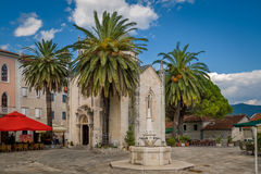 Herceg Novi old town touristic center. Church , palms and drinkable fountain. Montenegro Royalty Free Stock Image