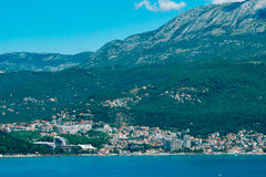 Herceg Novi, the view from the shore on the contrary, against th. E background of mountains and sky, Montenegro, Adriatic royalty free stock photography