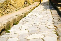 Herculaneum, ancient Roman town. Ancient road paved with stone, Ercolano, Italy stock photography
