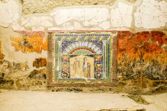 Herculaneum, ancient Roman town. Wall with ancient Roman mosaic with Neptune and Amphitrite. Archeological site, Ercolano, Italy. Herculaneum, ancient Roman town royalty free stock photography